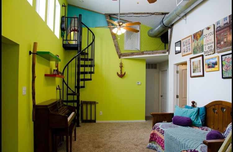 Spiral staircase leads to the shark tank, or 4th bedroom, designed just for kids