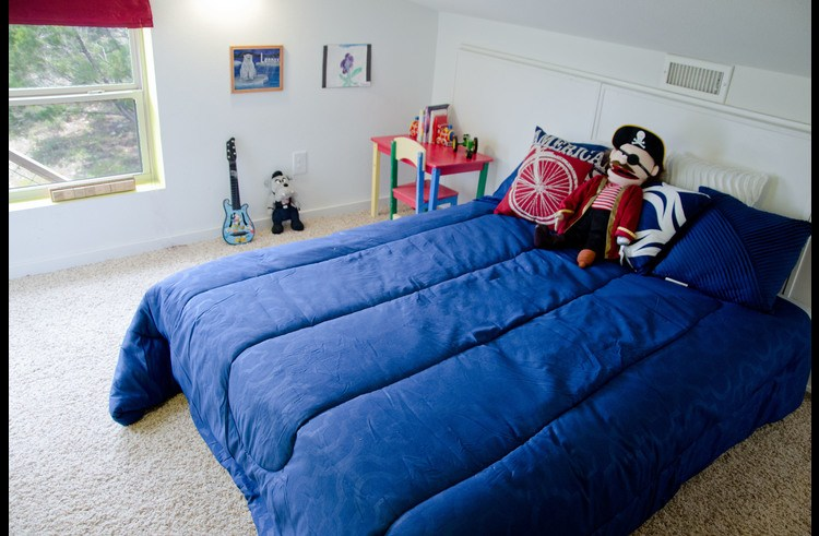 The upstairs bedroom (shark tank) has a queen futon and toys for the kids