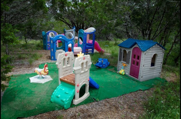 Kids play area along the side of the house