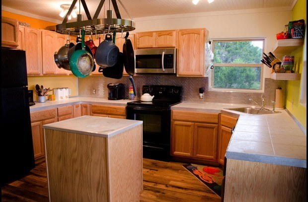 The fully stocked kitchen also has a range, microwave and dishwasher