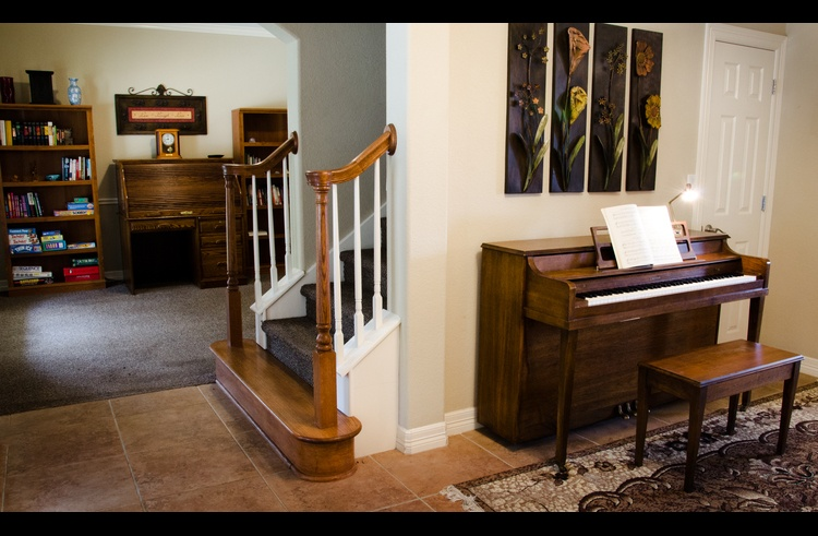 This is the entryway with the office to the left, stairs to 2nd floor and piano in the foyer.