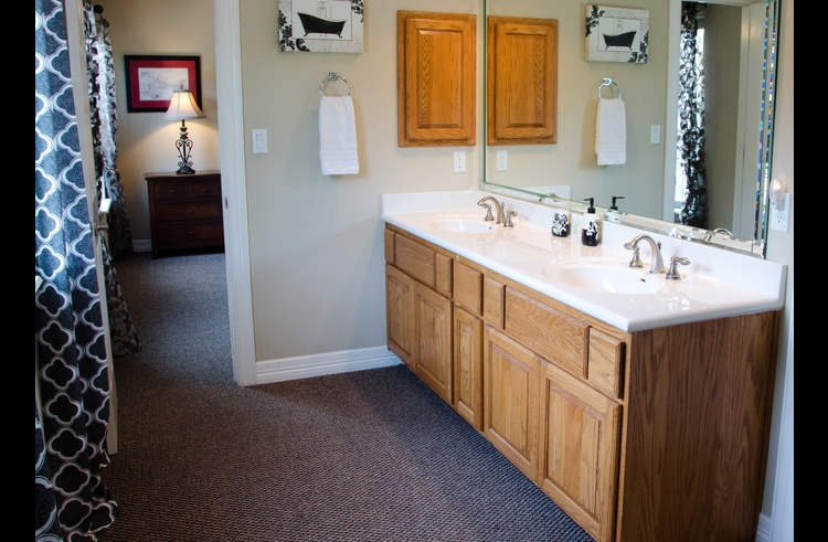 One of two upstairs bathrooms, this bath connects the two queen bedrooms and has a separate shower/toilet area.