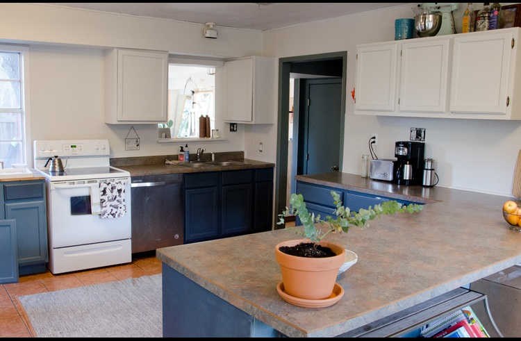 The spacious kitchen is fully stocked with cookware, utensils and dishes.