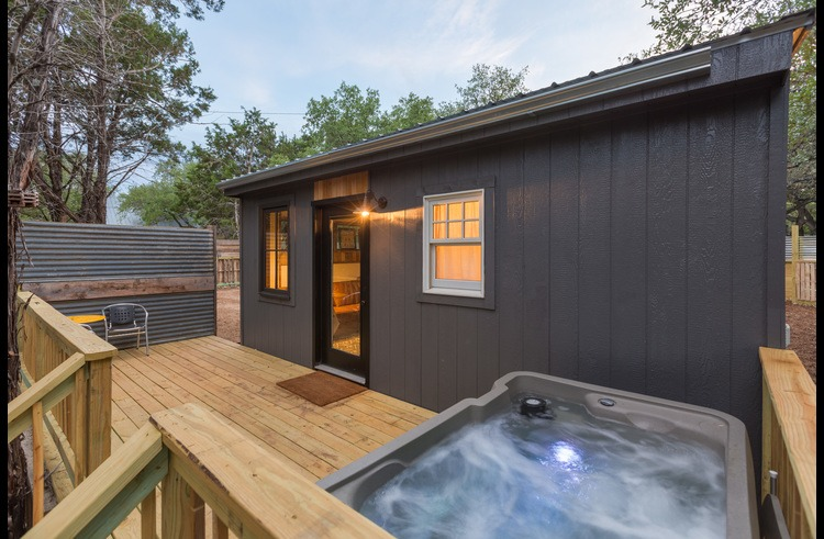 The back deck features a two person hot tub under the stars