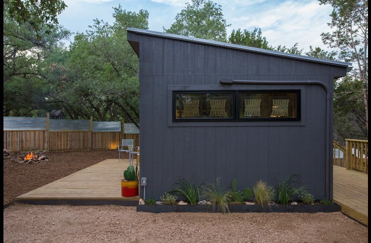 The native water-wise landscaping is one of the many green features of this tiny home