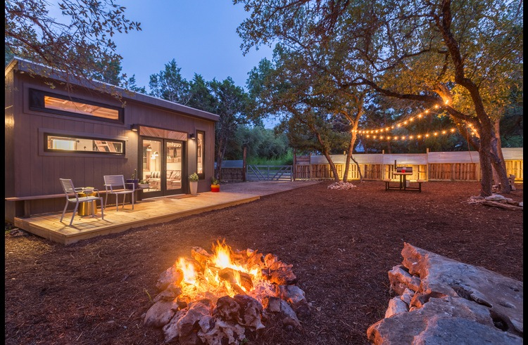 The yard at Sundown is fully fenced, private and spacious. It features a fire ring, hammock, BBQ, outdoor seating, ample lighting and a lovely front deck