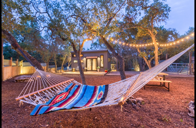 The double hammock is in a dreamy spot under the twinkle lights