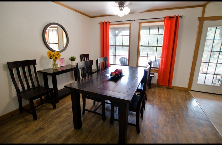 The dining table has seating for 6 inside, plus there's a picnic table with additional seating outside.
