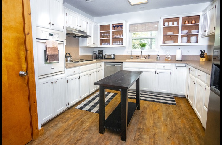 This kitchen is fully equipped with cookware & dishes. Just add food, laughter and friends!