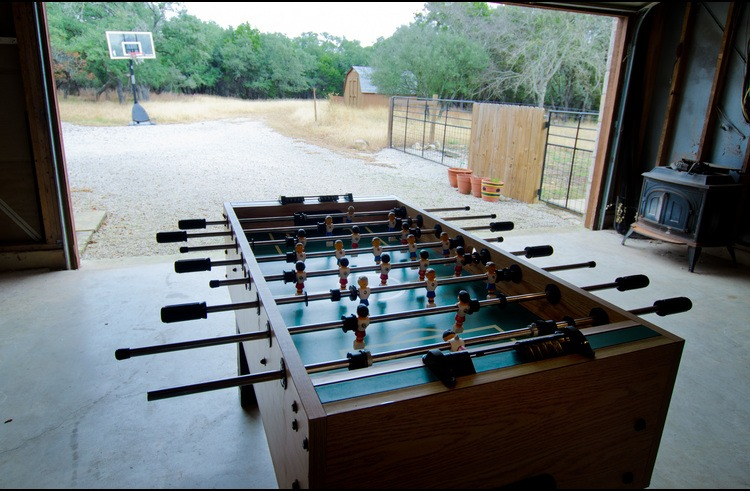 The garage has a foosball table and there's a basketball goal just outside on the drive.