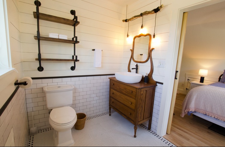 The upstairs bath is super romantic with a flair for the vintage & claw foot tub