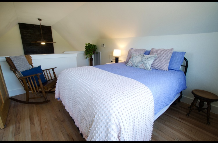 The upstairs loft master suite features a queen bed and attached, private bath.