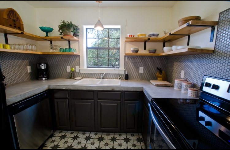 Oh, how we LOVE this kitchen! It has a concrete counter & fun selection of dishes.