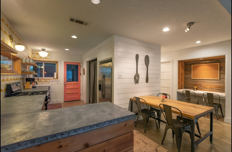 Cook, dine & lounge together in this open kitchen/dining space