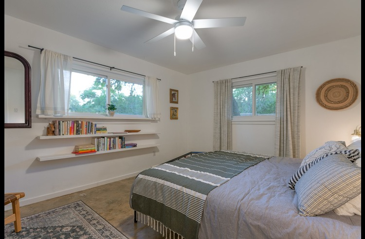 Master bedroom with king bed and lovely natural light