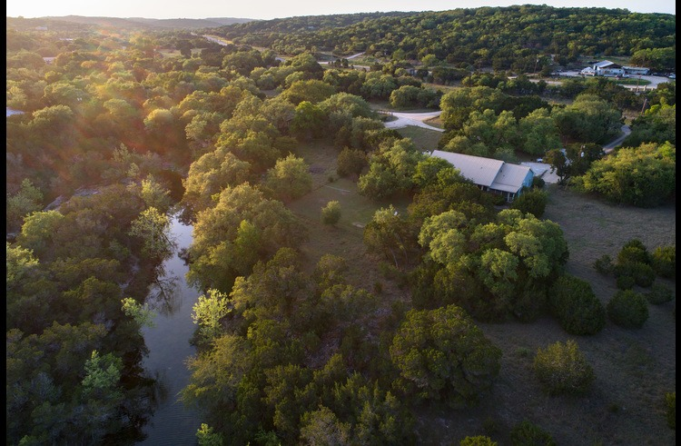 Aerial view of the home, surrounding property and creek. It's a pretty special spot!