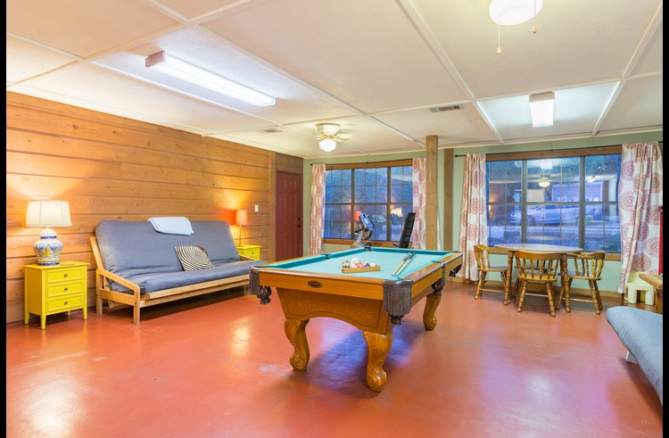The spacious game room features two queen futons, a pool table and games for all ages.