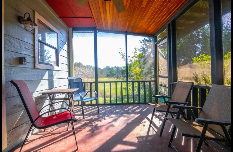 The screened-in back porch faces only nature and is great for viewing deer and other wildlife.