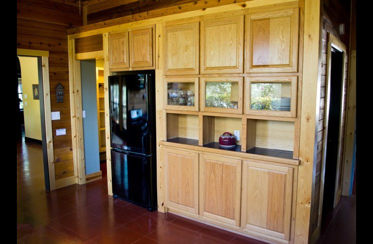 The other side of the kitchen with more custom cabinets by Gregory and a walk-in pantry!