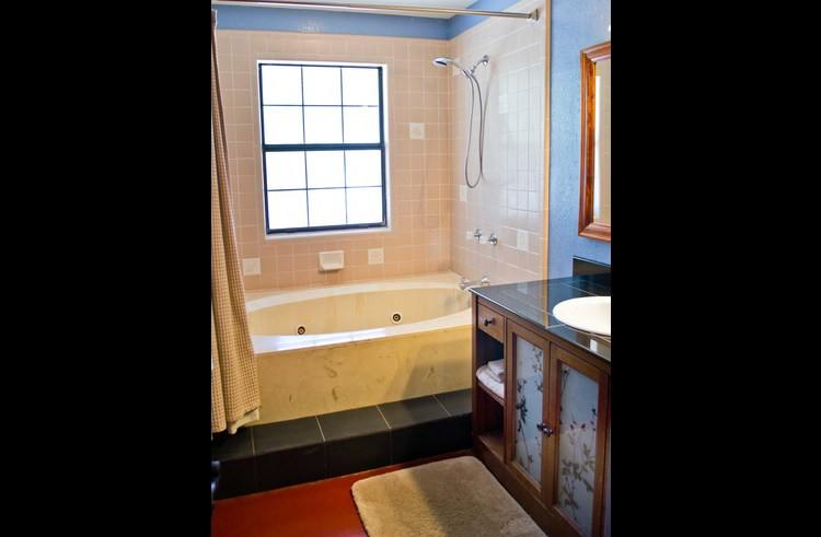 The master bath features a Jacuzzi tub.