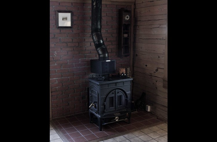 The wood burning stove makes for cozy winter days.