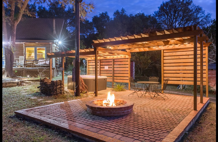 The outdoor veranda with the hot tub, patio set and fire pit is a wonderful place to enjoy the evening together.